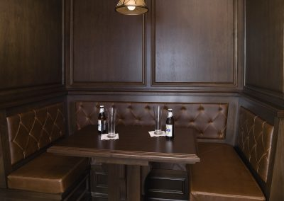Warm wood bar booth in family room