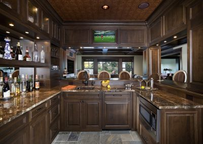 Luxurious dark wood bar built into family room