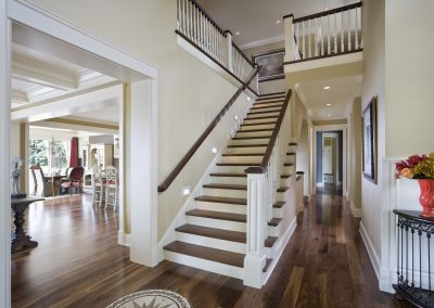Entryway to house showing beautiful stairwell with view to rest of house