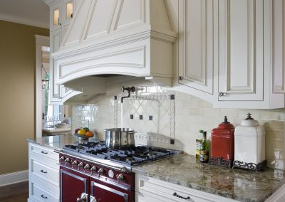 Red La Cornue stove in white french country style kitchen